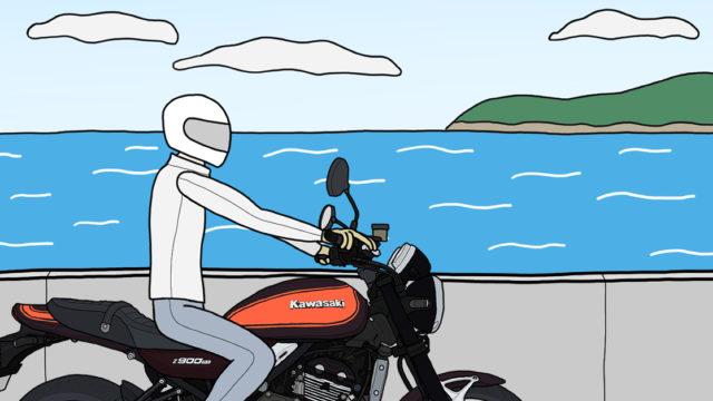 海沿いの道 バイク バイクに乗って走っている人