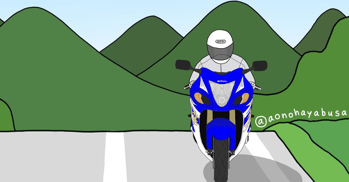 ツーリング 山 道路を走るバイク